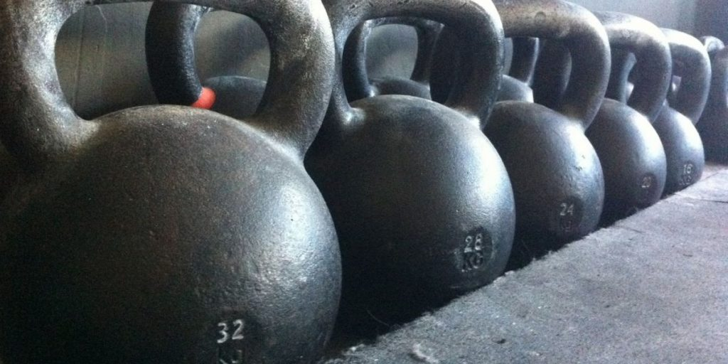 kettlebells vs adjustables